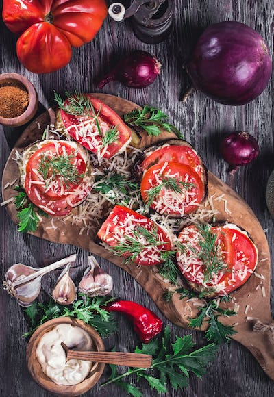 Eggplant and tomato stacks rustic above view