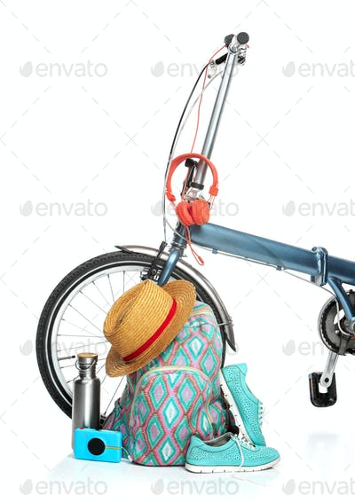 The new modern bicycle and suitcase, sneakers, thermos