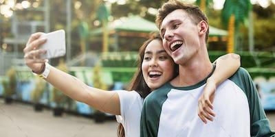 Teenage Couple Amusement Park Selfie Concept