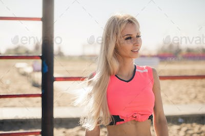 Beautiful athlete woman doing sport exercising on the beach