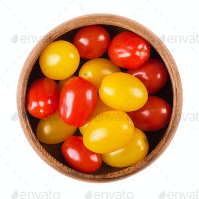 Cocktail tomatoes in a bowl on white background