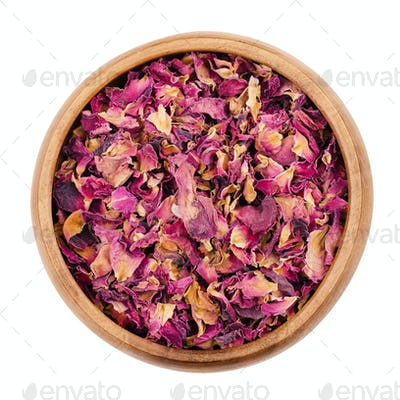 Rose petals in a bowl over white