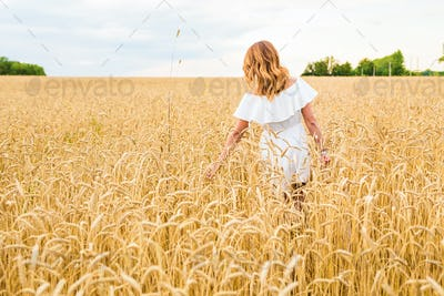 woman touching golden rye