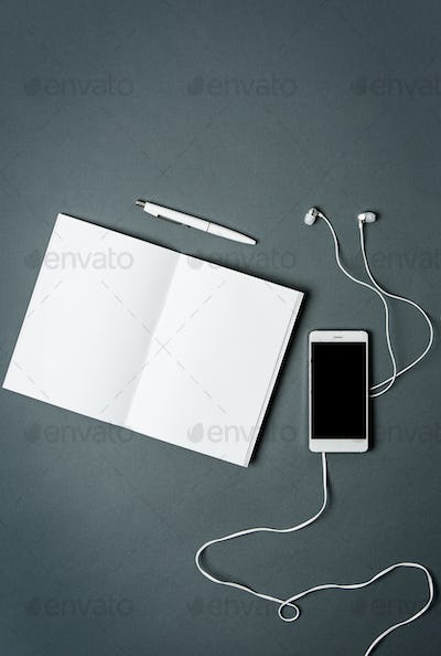 Mock-up business notebook, phone. Gray background.