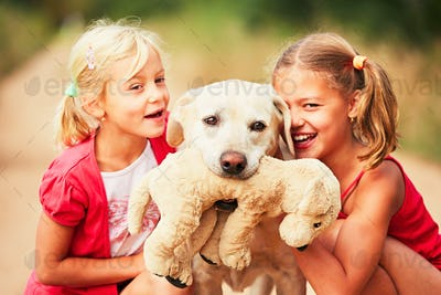 Sisters with dog.