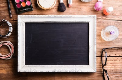 Picture frame with copy space, various make-up products