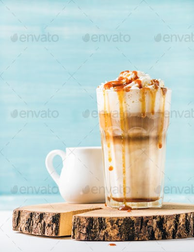 Latte macchiato with whipped cream and caramel sauce