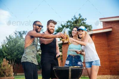 Happy teens having fun at the picnic area