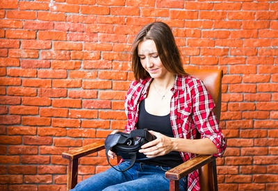 Woman with virtual reality headset enjoying her experience