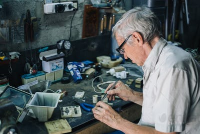 Senior engineer working in garage