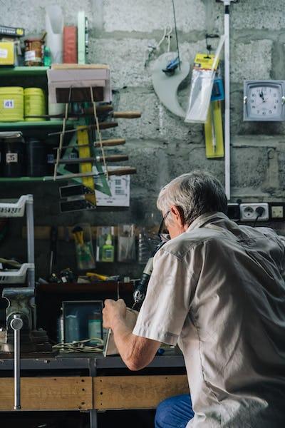 Senior mechanic working in garage
