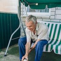Senior man playing with dog