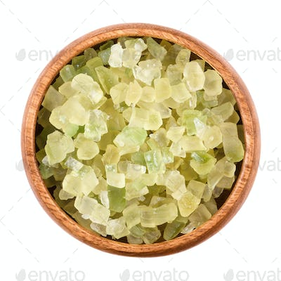 Diced green succade in a bowl over white