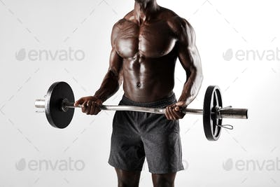 Muscular african male exercising with barbell