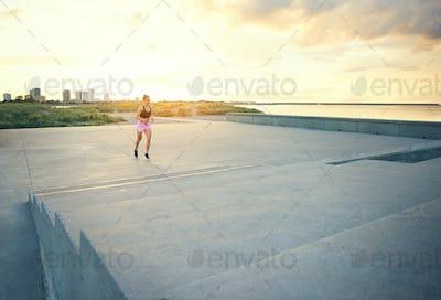 Healthy young woman enjoying a morning run