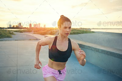 Sporty strong healthy young woman