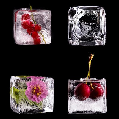 Various fruits and flower into ice cubes
