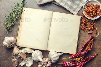 Blank cookbook and ingredients.