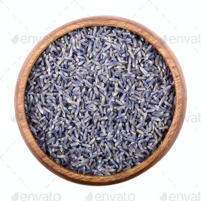 Dried lavender flowers in a bowl over white