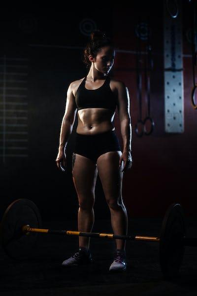 Sporty female in gym