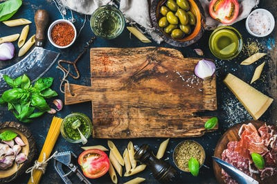 Italian food cooking ingredients on dark background
