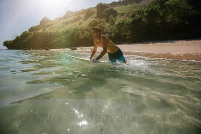 Man surfing in the ocean water with surf board