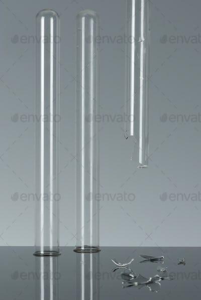 3 test tubes, one broken