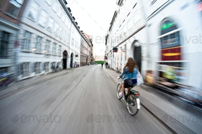 Girl on bike riding fast - motion blur