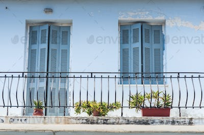 typical mediterranean balcony with flower pots