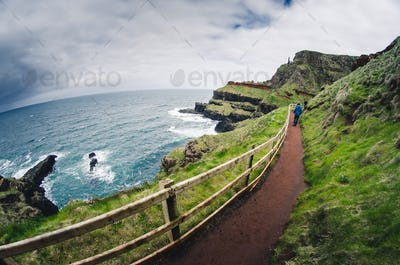 Narrow path at the rocky coastline