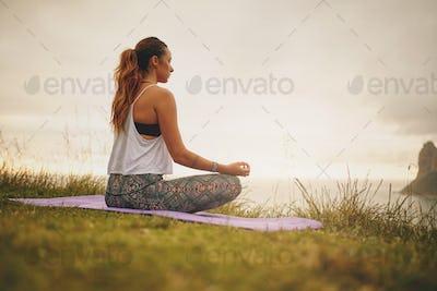 Fitness female model practicing yoga