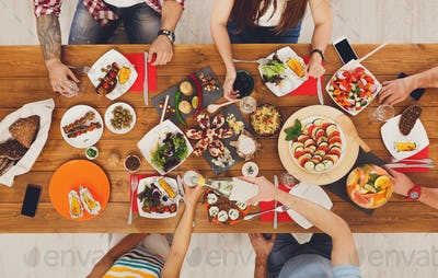People eat meals drink alcohol at festive table dinner party