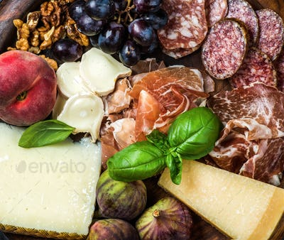 Italian snacks for wine variety over wooden tray background