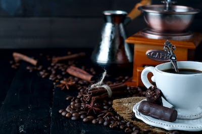 Chocolate candy with cup of coffee