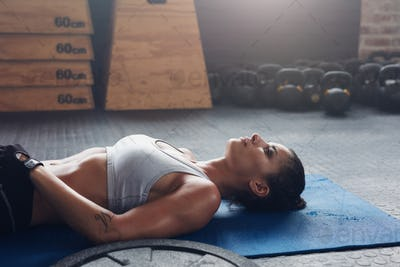 Healthy female athlete taking a break from fitness training