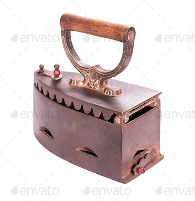 Old charcoal iron isolated back view