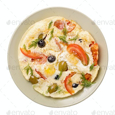 Scrambled eggs with tomatoes and olives isolated