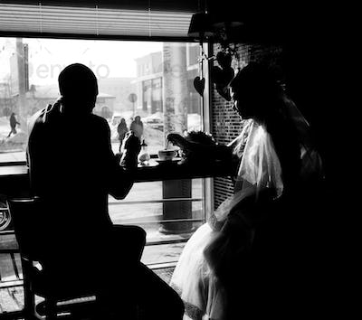 Silhouette of bride and groom in cafe