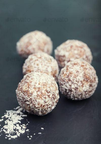 Handmake almond healthy energy balls on slate of tile