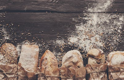 Bread bakery background. Brown and white wheat grain loaves composition