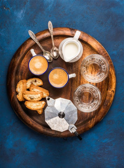 Coffee espresso, cantucci, cookies and milk on wooden serving board