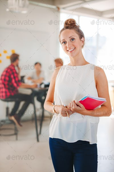 Happy business woman with coworkers meeting
