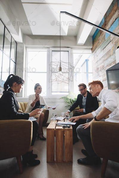Creative people having meeting in modern office