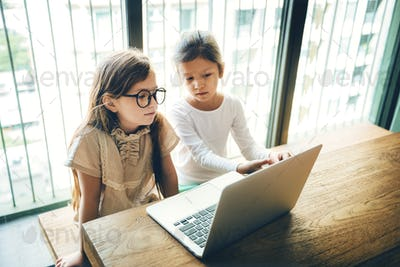 Little Girls Using Computer Concept
