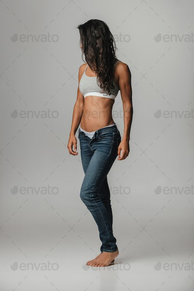 Strong beautiful tanned woman wearing halter top
