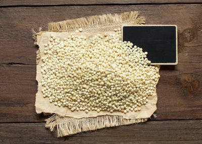 White Sorghum grain with a small chalkboard