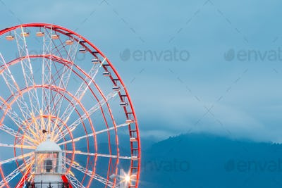 Batumi Georgia. Close View Of Ferris Wheel And Top Of White Ligh