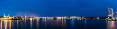 Riga Latvia. Panoramic Cityscape In Evening Illumination On Both