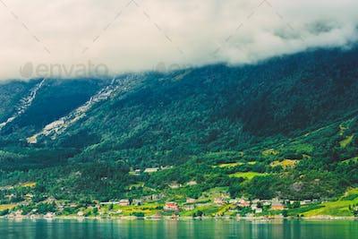 Scandinavian Village On Shore Of Hardangerfjord In Norway.