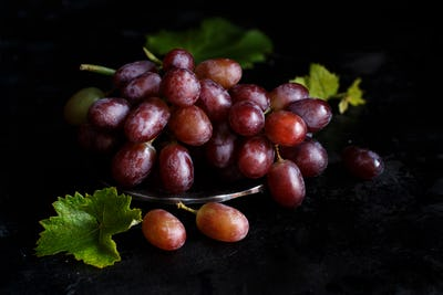 Red grapes on a dark Background